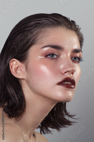 Fotografie, Obraz  Beauty portrait of woman with wet skin and and dark lipstick