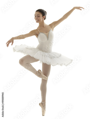 Photo  ballerina with white tutu doing the pique pose on white background