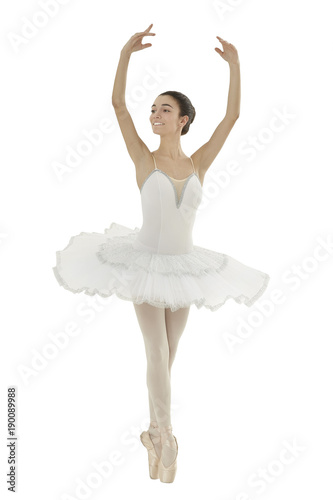 ballerina with white tutu doing the releve pose on white background Canvas Print
