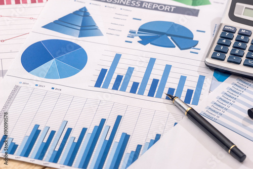 Financial Development Calculator And Pen On Chart And Graph Paper