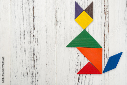 Poster Graffiti wooden tangram in a fox shape with copy space