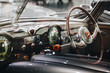 Interior vintage car with steering wheel and dashboard