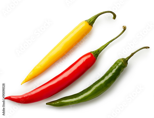 Spoed Foto op Canvas Hot chili peppers Three colorful chili peppers
