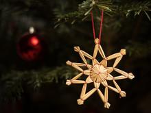 A Straw Star Hanging On A Chri...