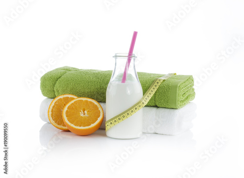 Obraz Protein shake with oranges and towels. Summer diet - fototapety do salonu