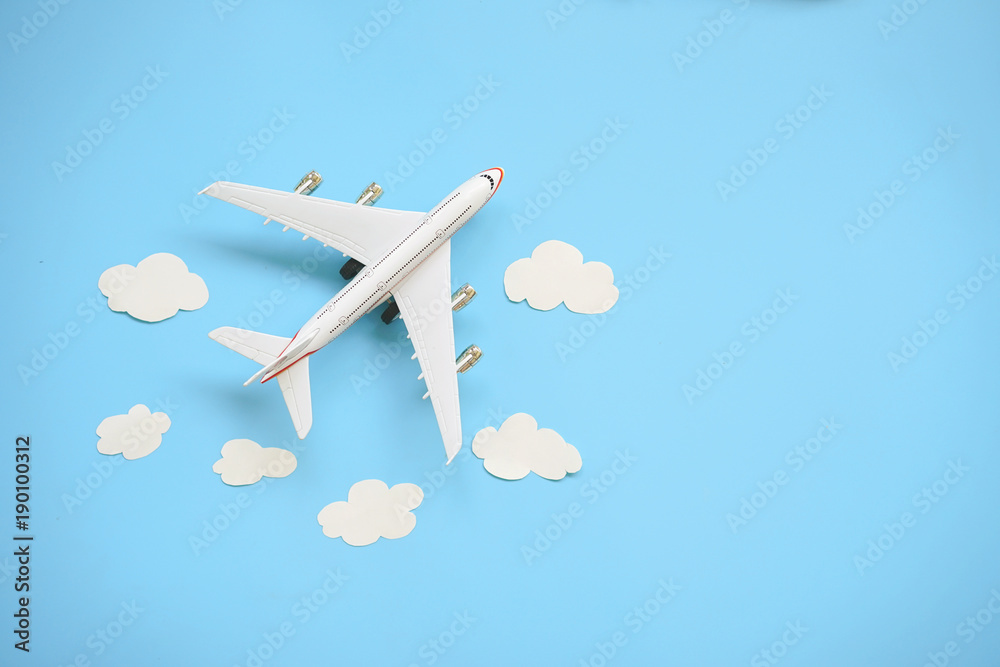 Fototapety, obrazy: Flat lay design of travel concept with plane and cloud on blue background with copy space.