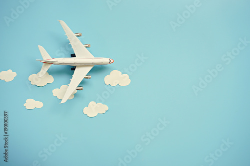 Cuadros en Lienzo Flat lay design of travel concept with plane and cloud on blue background with copy space