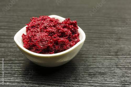 Obraz na plátně A bowl of grated beetroot with horseradish.
