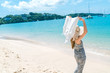 girl wearing a sea cap standing on the beach, clear sky, beautiful sea for relax, copy space.