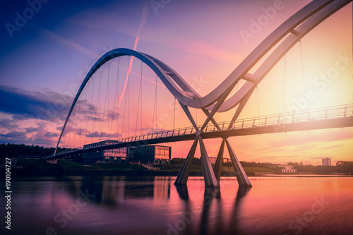 Recess Fitting Bridge Infinity Bridge on dramatic sky at sunset in Stockton-on-Tees, UK.