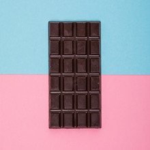 Dark Chocolate Bar Isolated On A Color Background