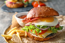 Tasty Burger With Fried Egg On Plate, Closeup