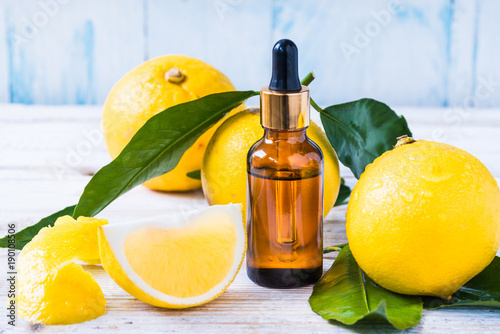 Fototapeta Bergamot citrus essential oil, aromatherapy  natural organic beauty essence.Essential citrus oil bottle on white wood background. obraz