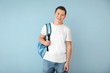canvas print picture - Teenage boy with backpack on color background