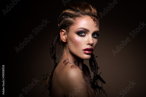 Wall Murals Beauty Fashion model with bright makeup and colorful glitter and sparkles on her face and body