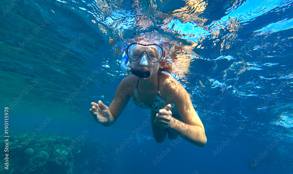 Fototapeta girl and snorkeling