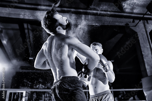 Photo  Young professional boxers training in ring