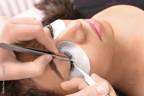 Fotografie, Obraz  Young woman undergoing eyelash extensions procedure, closeup