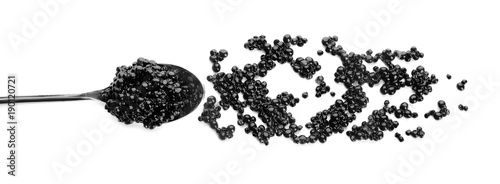 Black caviar in spoon on white background