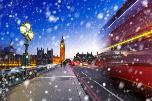 Big Ben and Westminster bridge on a cold winter night with falling snow, London, Canvas Print