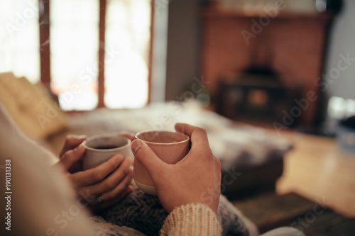 Couple with coffee sitting at home Fototapet