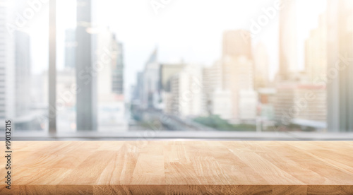 Fotografiet  Empty wood table with blur room office and window city view background