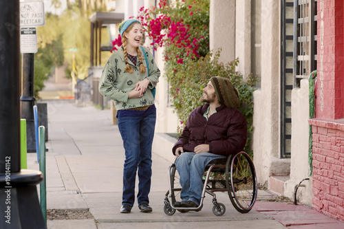 Fotografie, Obraz  Young Woman and Man in Wheelchair Talking