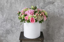 Beautiful Tender Bouquet Of Flowers In White Box On Gray Ackground With Space For Text