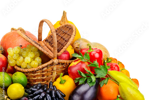 Basket with fresh fruits and vegetables isolated on a white background. © Serghei Velusceac