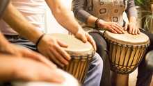Close Up Of Hands On African Drums, Drumming For A Music Therapy