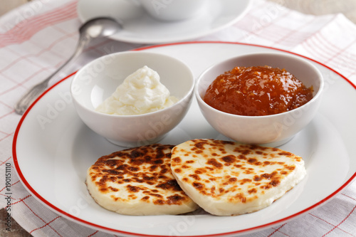 Vászonkép Cheese, cloudberry jam, and whipped cream