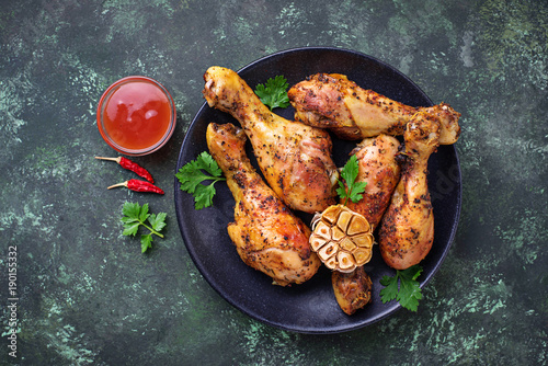 Grilled chicken legs with spices and garlic. Fototapeta