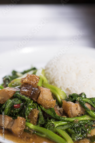 Chinese broccoli and crispy pork belly stir fry over rice - Buy this