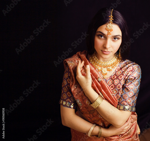 Fotografie, Obraz  beauty sweet real indian girl in sari smiling on black backgroun