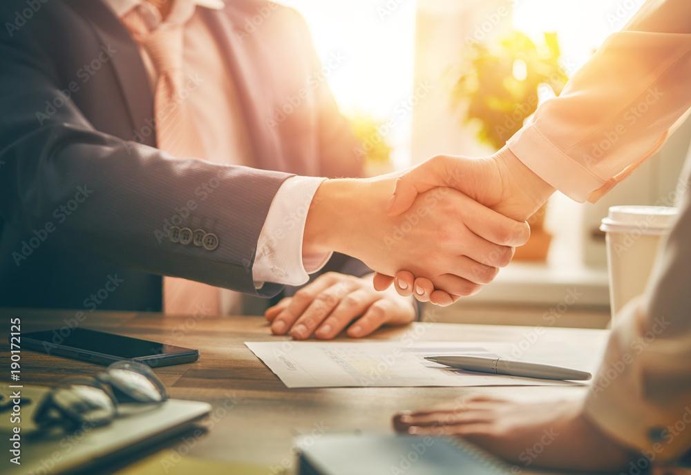 Fototapeta handshaking in office
