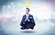 Businessman Meditates With Enlightenment Concept