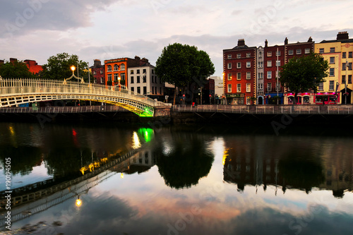 Stampa su Tela  Morning view of famous illuminated Ha Penny Bridge in Dublin, Ireland