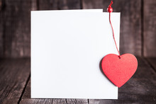Blank Paper Greeting Card Decorated Red Heart Shape On Dark Wooden Background