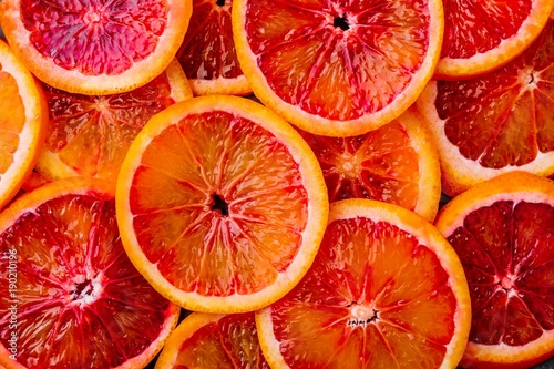 Background made of ripe juicy blood orange slices.