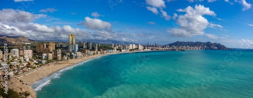 Fotografia, Obraz Panoramic view Benidorm with high buildings, mountains and sea