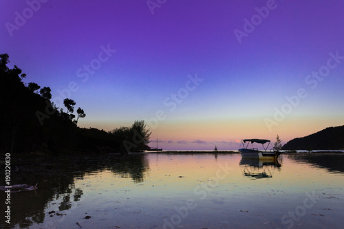 Acrylic Prints Horseback riding View of the Madagascar Island coastline, lined palm trees and boats floating in the sea at sunset, Madagascar