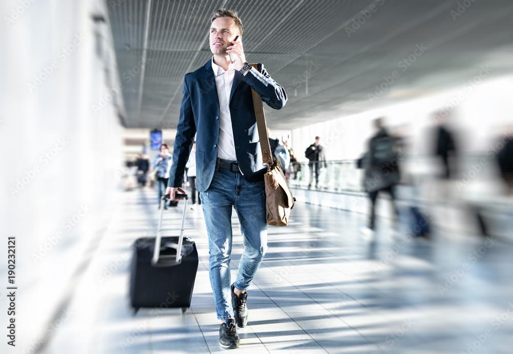 Fototapety, obrazy: Businessman walking in airport