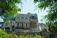 Abandoned Cottage, House With Statue Of Two Elephants In Samara, Russia