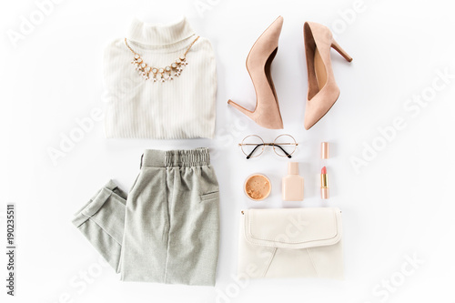 Woman clothes and accessories set on white background top view. modern and casual outfit. fashion, shopping and makeup concept. Flat lay, top view.  - fototapety na wymiar