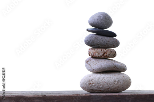 Fotografía  Balance Stones stacked placed on a wooden floor.