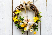 Easter Background With Spring Easter Eggs And Flowers, Wreath On Door