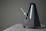Monochromatic metronome in action isolated and on a plain background
