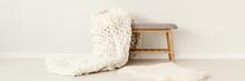 White Knit Blanket On Stool