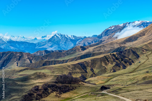 Poster Blauw amazing view of spring day landscape Caucasus mountains with blue sky Russia, Republic Ingushetia