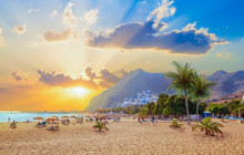 Beautiful Summer Scene On Teresitas Beach With People Enjoying Holiday In Sunset Light, In Tenerife, Canary Island Of Spain